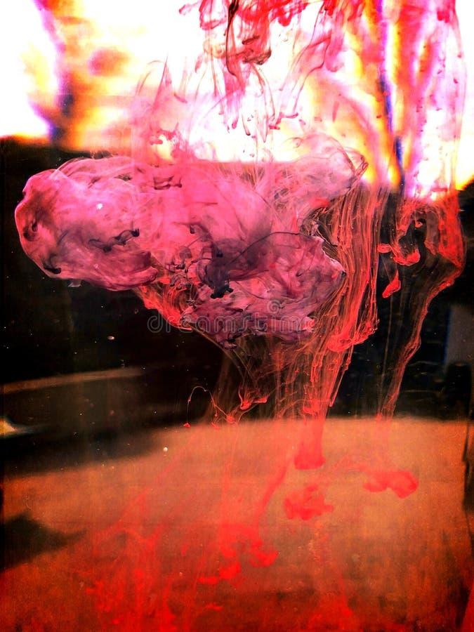 dyspersja barwione atrament krople w wodzie obraz royalty free