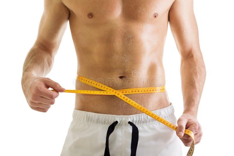 Dysponowany ciało bez koszuli mężczyzna z taśmy miarą obrazy stock