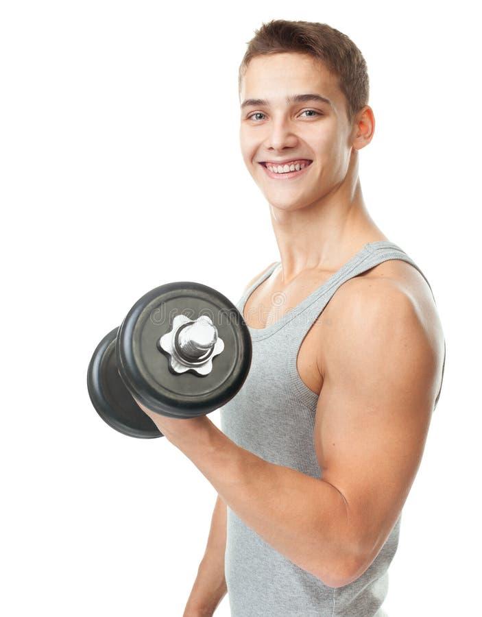 Dysponowany mężczyzna ćwiczy z dumbbells zdjęcia royalty free