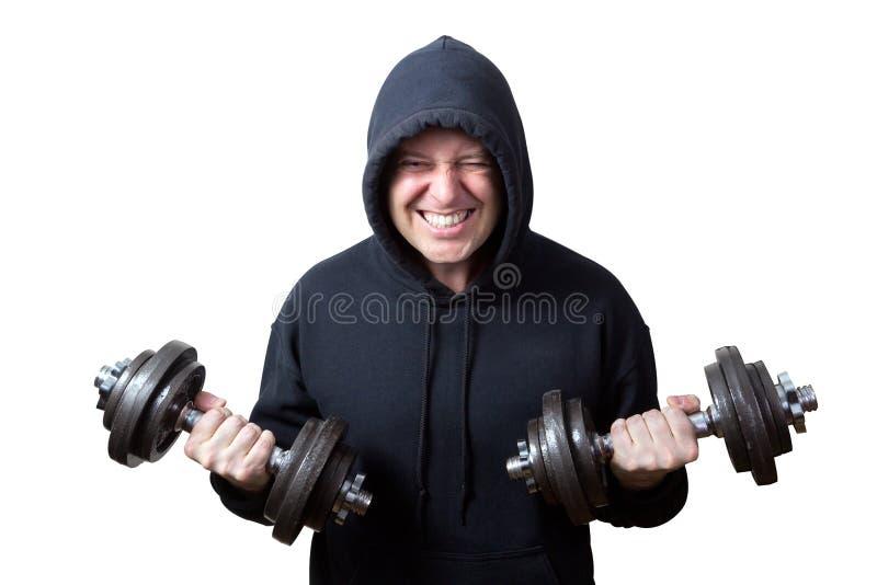 Dysponowany mężczyzna ćwiczy z dumbbells odizolowywającymi na bielu zdjęcie stock