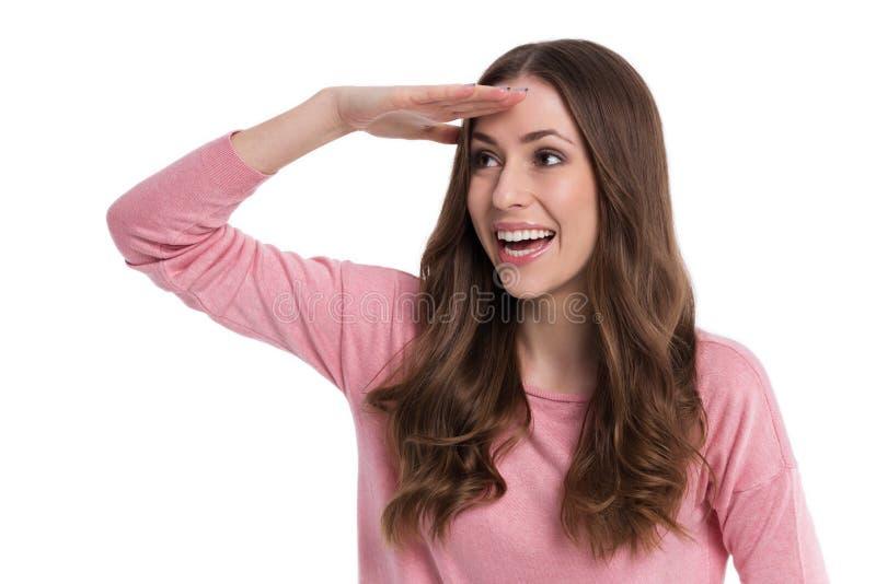 dystansowej czoła ręki przyglądająca kobieta fotografia stock