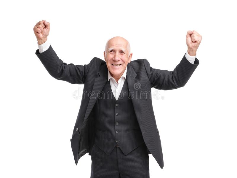 Dziadek bardzo szczęśliwy i podnosi jego wręcza up na białym odosobnionym tle obrazy royalty free