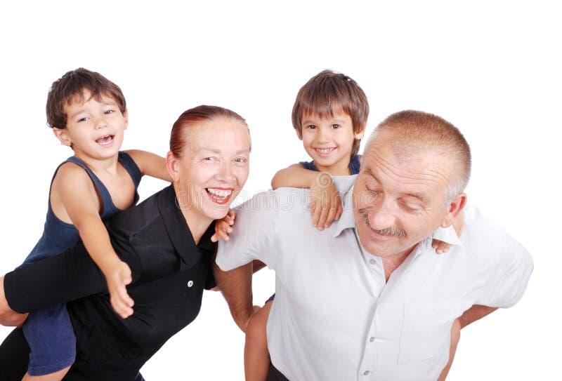 Dziadkowie piggybacking dwa chłopiec zdjęcia royalty free