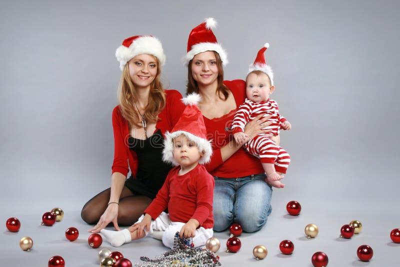 dzieci bożych narodzeń kapeluszy matki młode zdjęcia stock