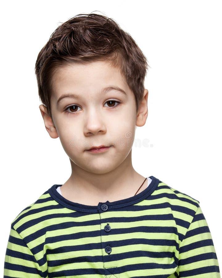 Dzieci emocje Zamyka w górę portreta intrygująca chłopiec zdjęcie royalty free