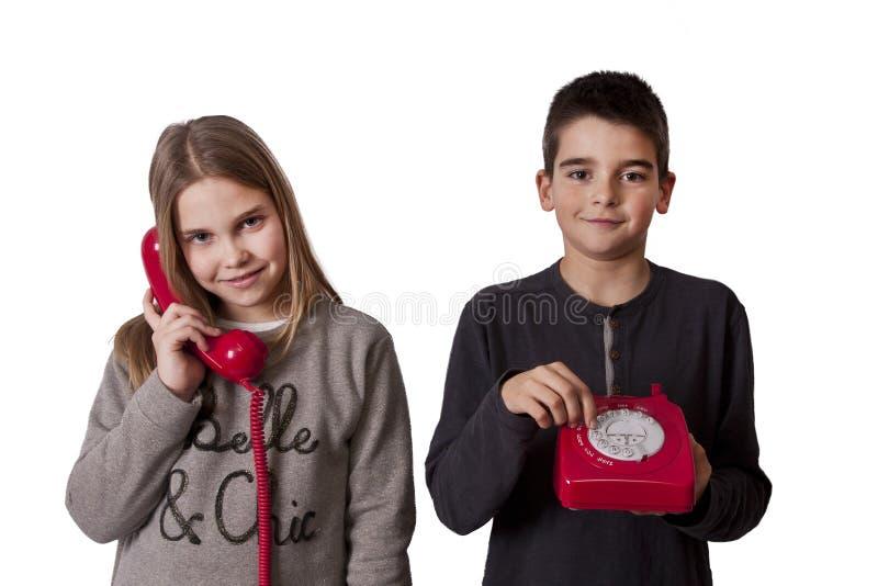 Dzieci na telefonie zdjęcie stock