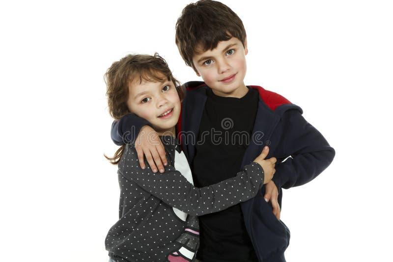 dzieci obejmowali portret fotografia stock