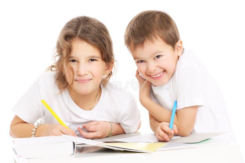 Dzieci robi pracie domowej obrazy royalty free
