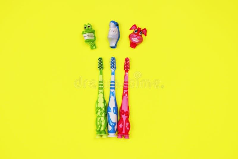 Dzieci toothbrushes na żółtym tle fotografia royalty free