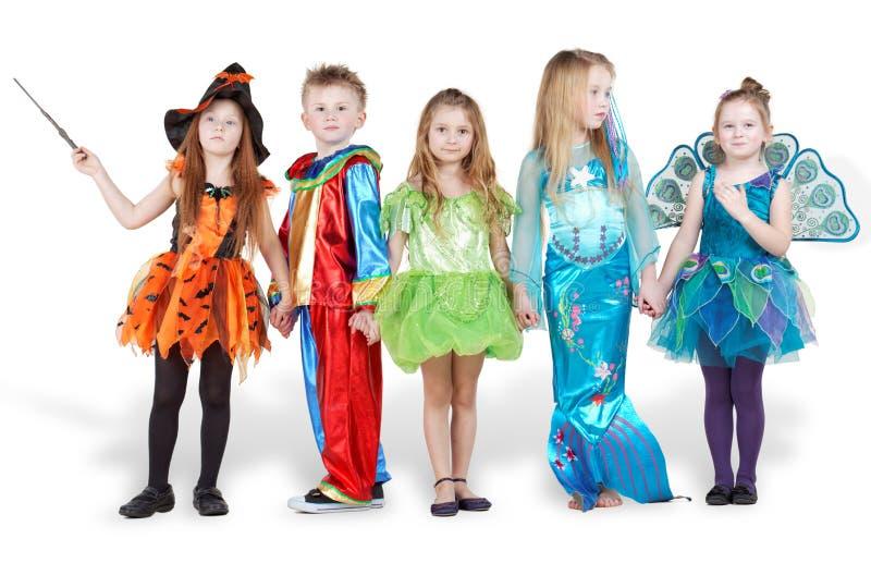 Download Dzieci W Karnawałowym Kostiumu Stojaku Zdjęcie Stock - Obraz złożonej z ręka, arlekin: 28969012