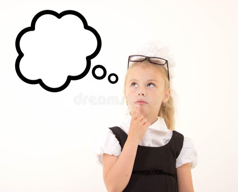 Dzieciak myśleć o coś, odizolowywający obraz royalty free