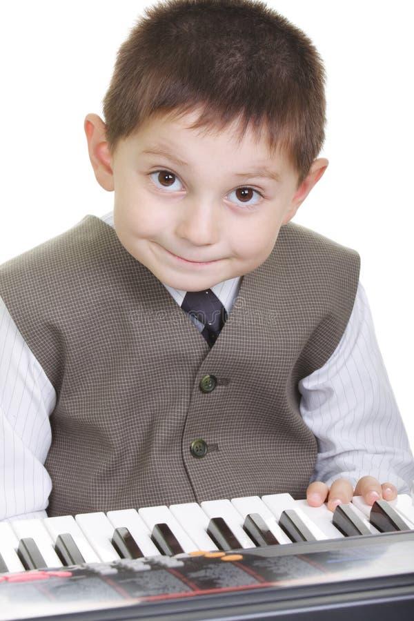 dzieciaka śliczny klawiaturowy pianino zdjęcia stock