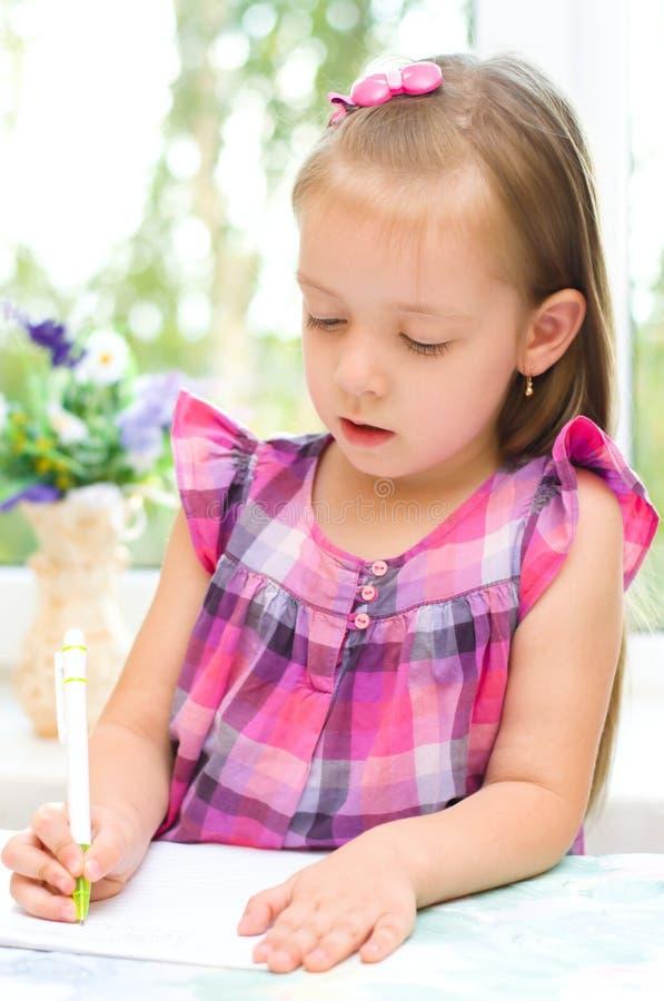 Dzieciaka writing zdjęcia royalty free