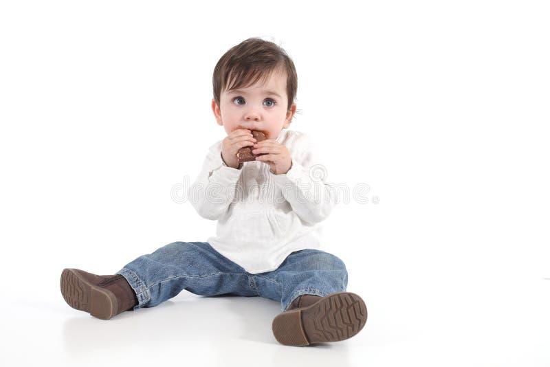Dziecka łasowania czekolada obraz royalty free