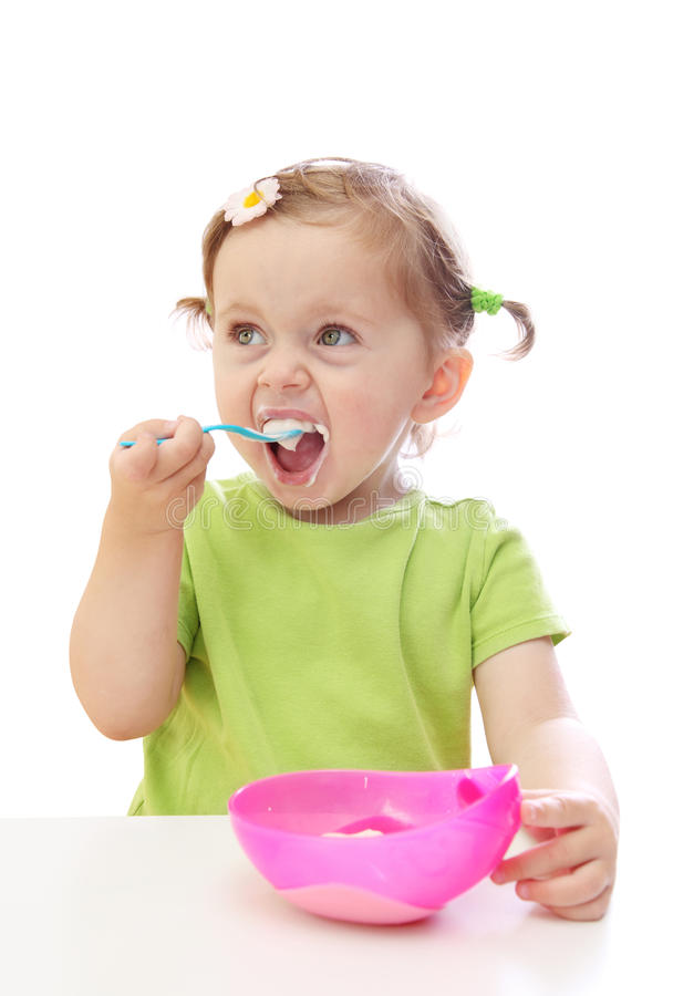 Download Dziecka łasowania Dziewczyny Jogurt Obraz Stock - Obraz: 10882349