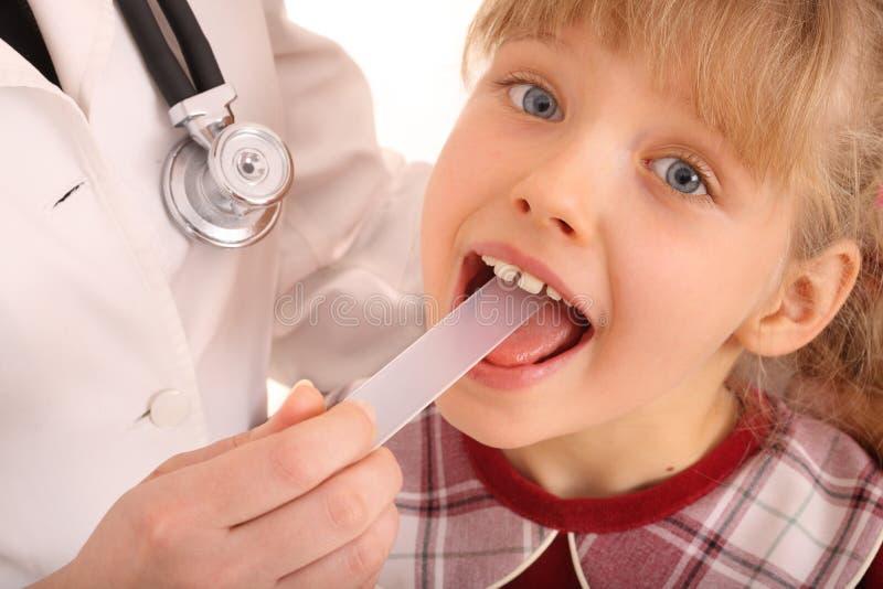 dziecka gardła doktorska funda zdjęcia stock