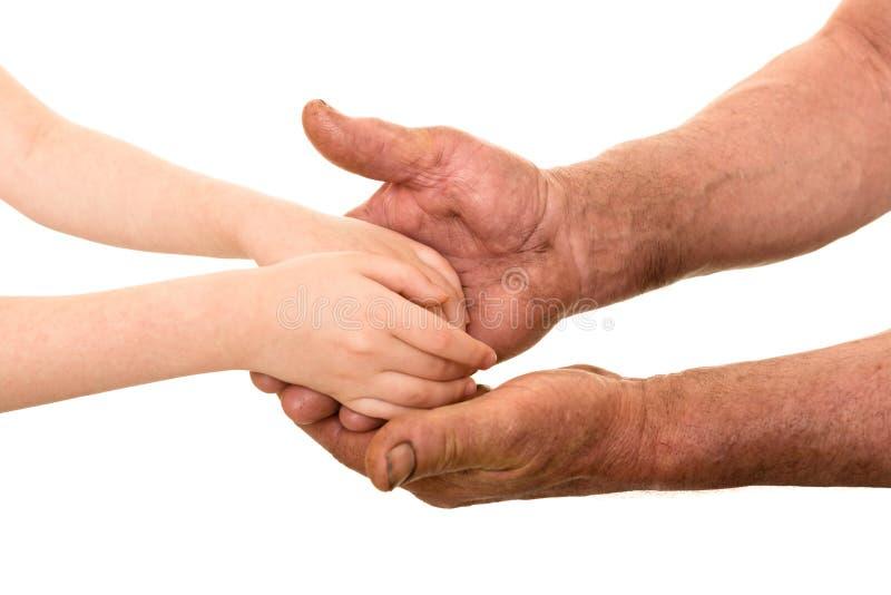 Dziecka i starego człowieka ręki obraz royalty free