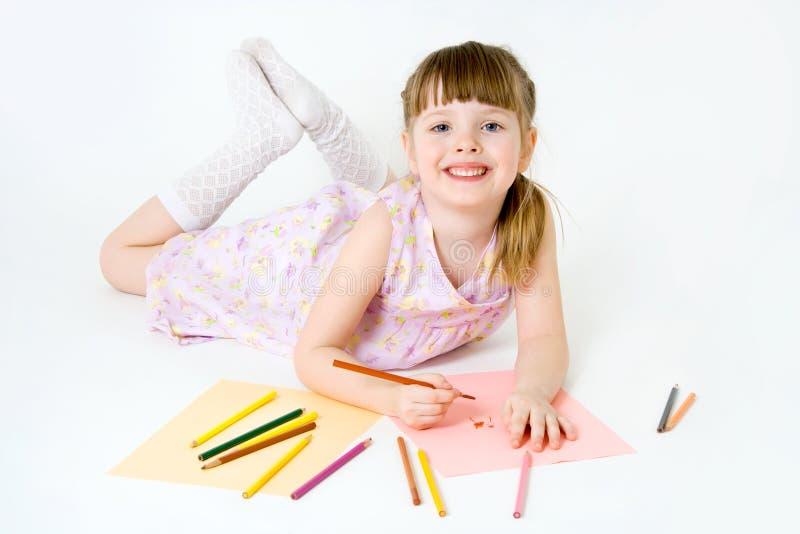 dziecka kolorowych kredek śliczny remisu uśmiech fotografia stock