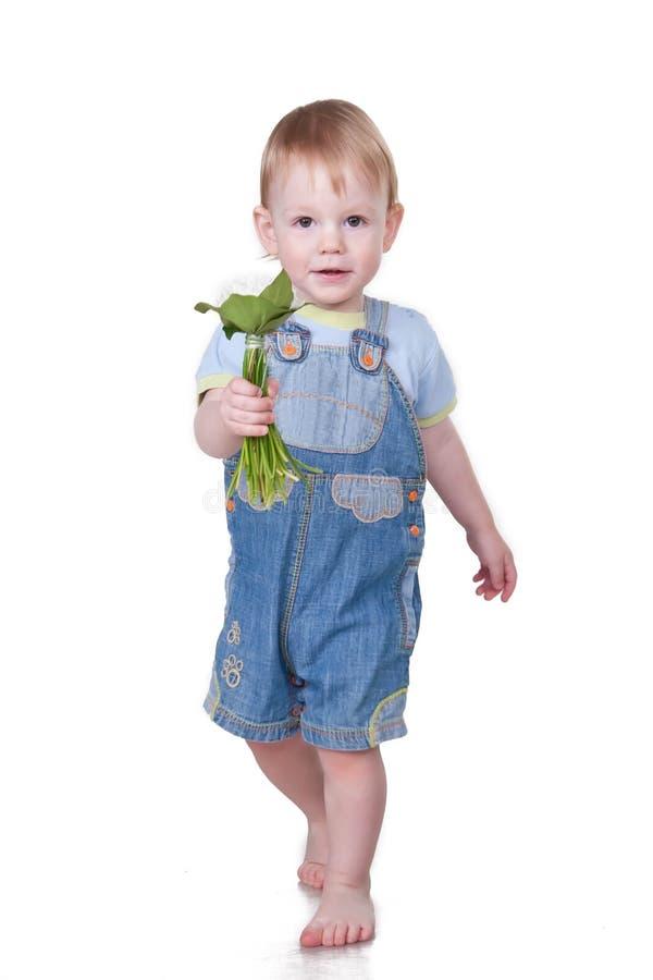 dziecka kwiatów dawać obraz stock