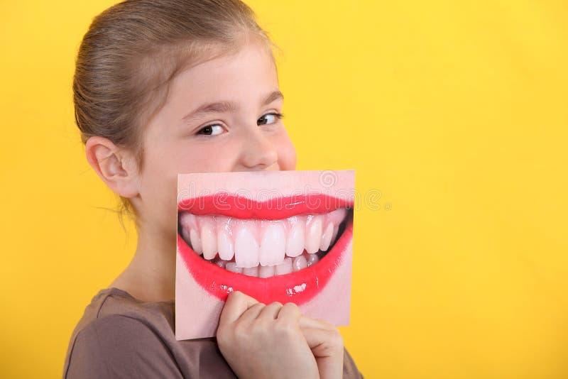 Dziecka mienia obrazek usta obrazy stock
