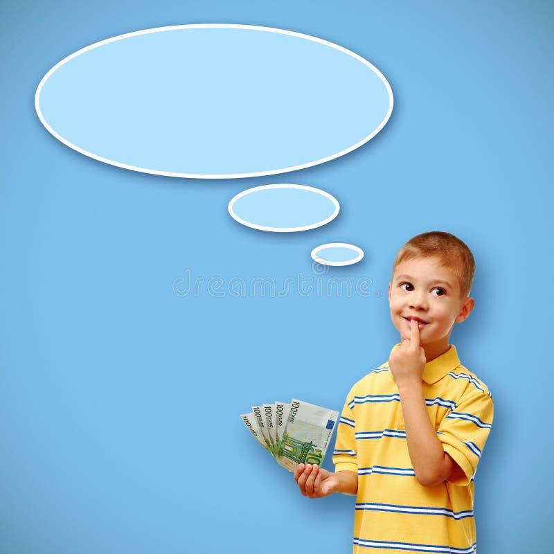 Dziecka mienia pieniądze i myśl bąbel obrazy stock