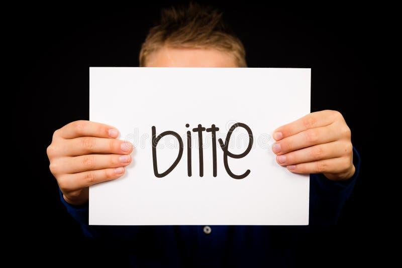Dziecka mienia znak z Niemieckim słowem Bitte - Zadawala zdjęcia royalty free