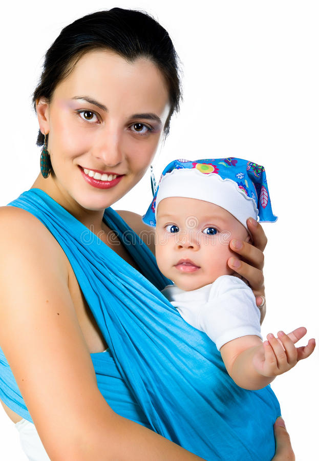 dziecka przewożenie jej macierzysty temblak obraz stock