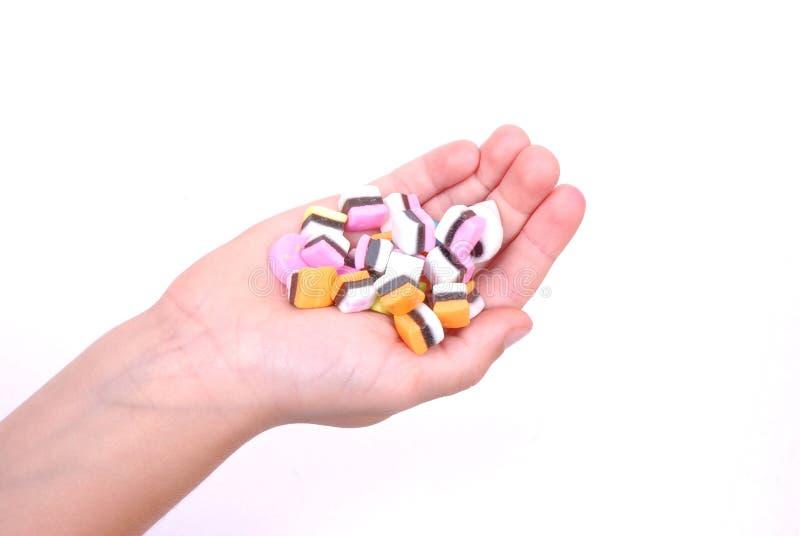 dziecka ręki cukierki zdjęcie stock