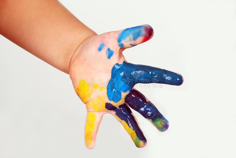 Dziecka ` s ręka plamiąca w kolorze farba zdjęcia stock