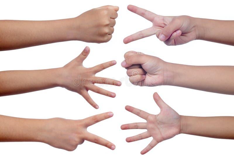 Dziecka ` s ręki robi znakowi jako skała nożyce i papier zdjęcia royalty free