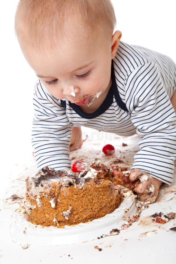 dziecka tortowego łasowania śmieszny smakowity fotografia stock