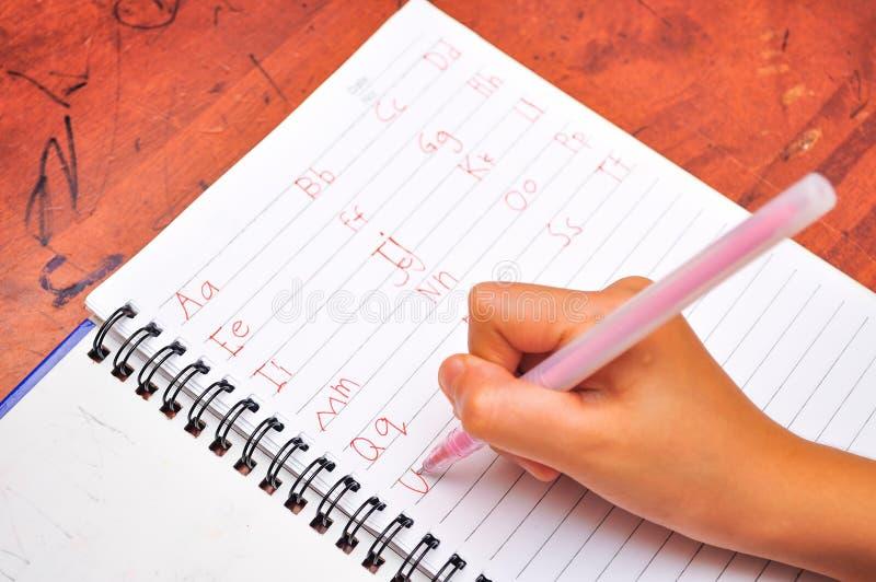 Dziecka writing abecadło fotografia stock