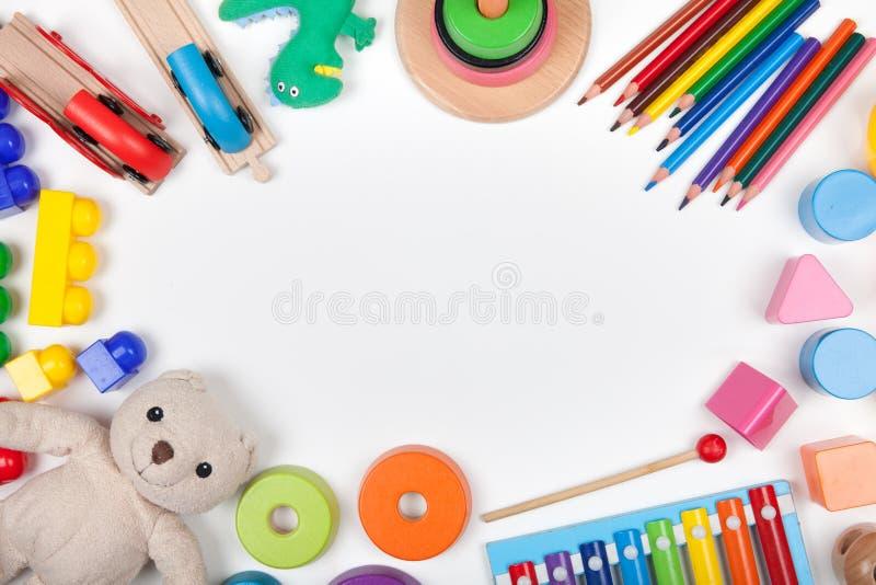 Dziecko żartuje zabawki ramę na białym tle z kopii przestrzenią dla teksta obrazy stock