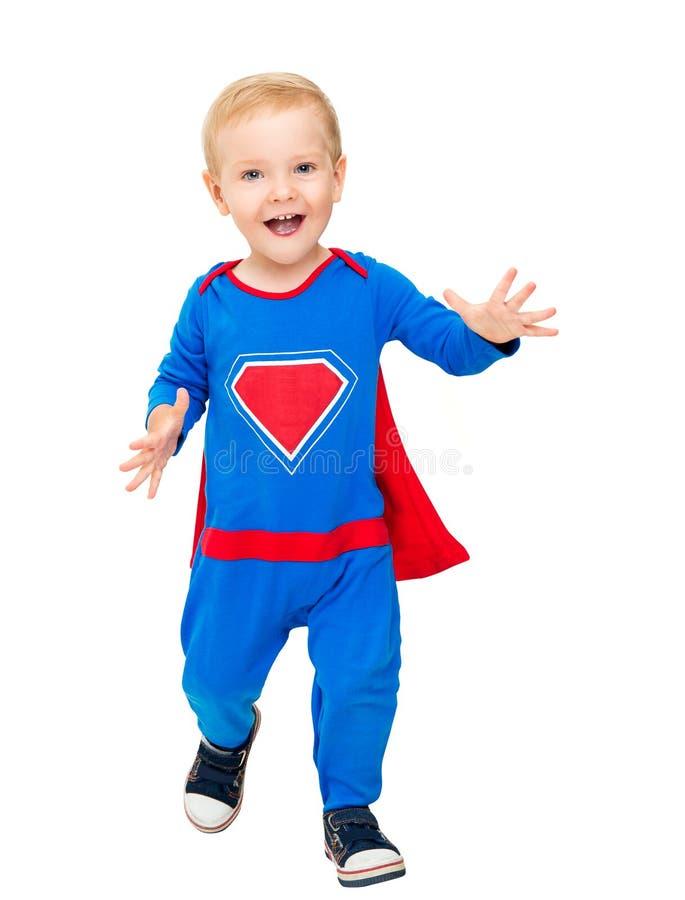 Dziecko bohater, dzieciak chłopiec Super bohatera kostium, Szczęśliwy dziecko nadczłowiek na bielu zdjęcia stock