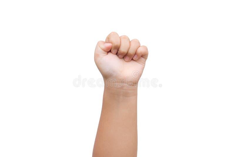 Dziecko chłopiec ręka pokazuje pięść jako skała papieru znak obrazy royalty free