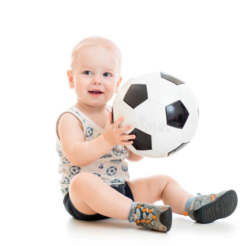 Dziecko chłopiec z nożną piłką obraz royalty free