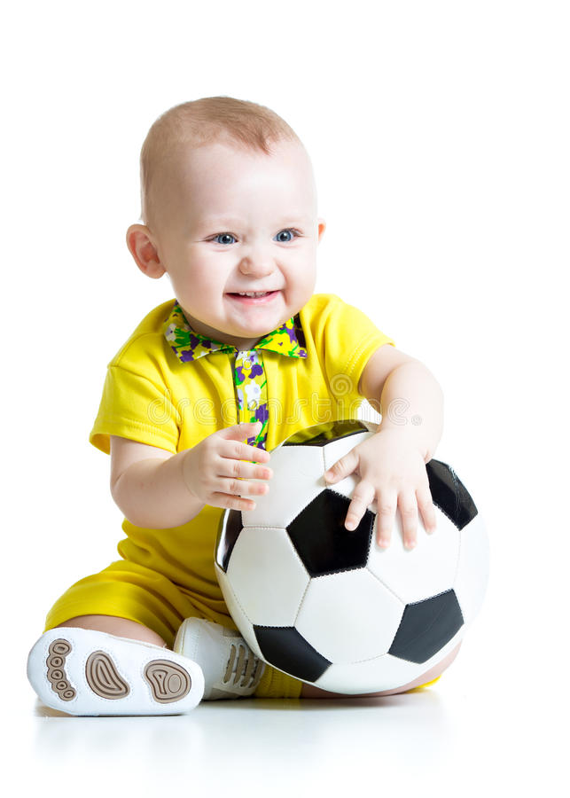 Dziecko chłopiec z nożną piłką fotografia stock