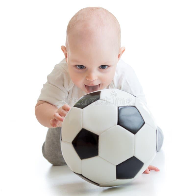 Dziecko chłopiec z nożną piłką obrazy stock
