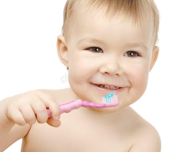 dziecko czyścić uśmiechów ślicznych zęby obraz stock