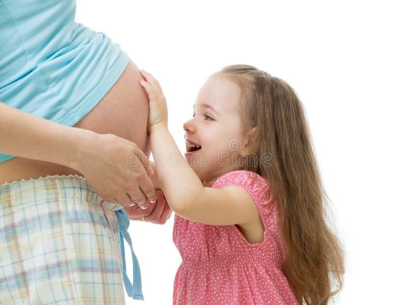 Dziecko dotyka brzucha kobieta w ciąży obraz royalty free
