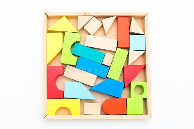 Dziecko drewniani barwioni bloki na białym tle odosobniony obraz stock