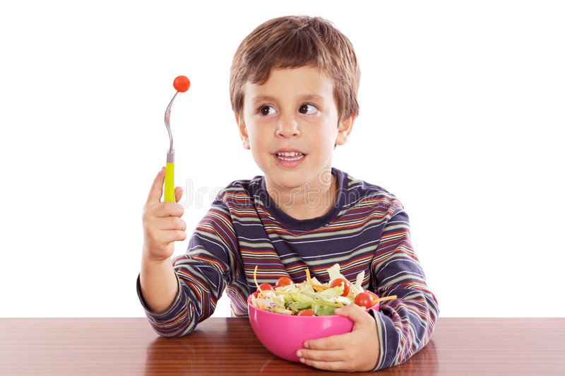dziecko jeść sałatki zdjęcia royalty free