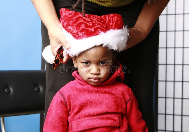 dziecko jest w Santa czapka niestety zdjęcia royalty free