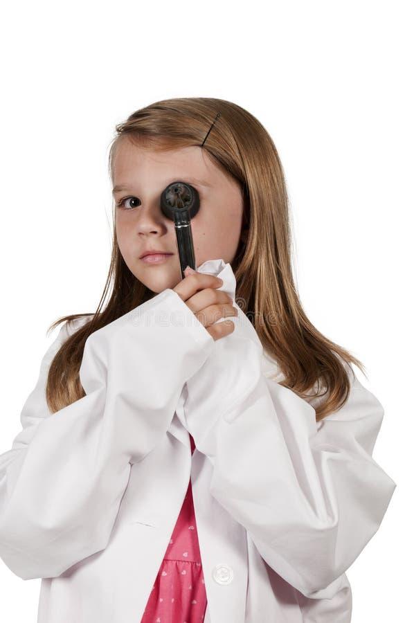 Dziecko lekarka z otoskopem zdjęcia stock