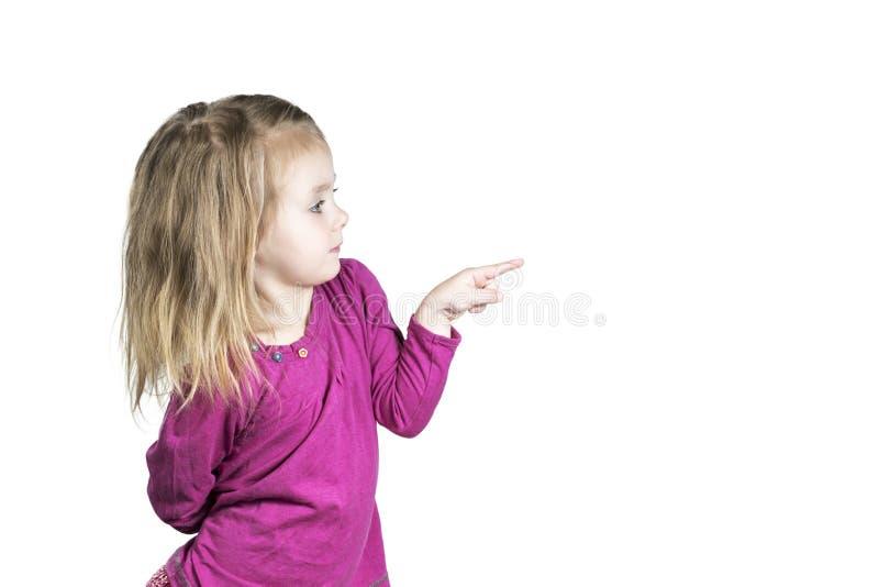 Dziecko punkty z jego dotykają z ukosa fotografia stock