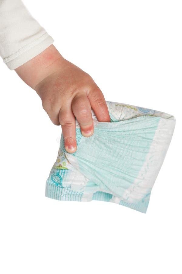 Dziecko ręki chwyta brudne pieluszki obrazy royalty free