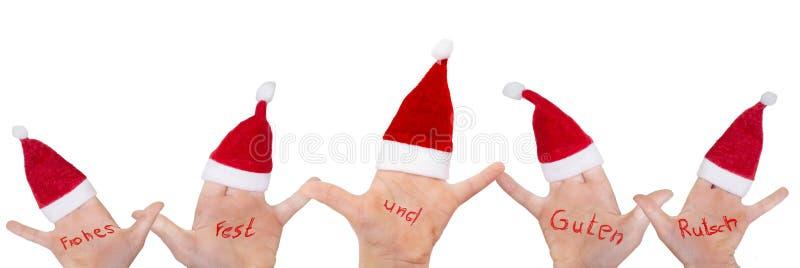 Dziecko ręki z Santa kapeluszami życzą wesoło boże narodzenia zdjęcia stock