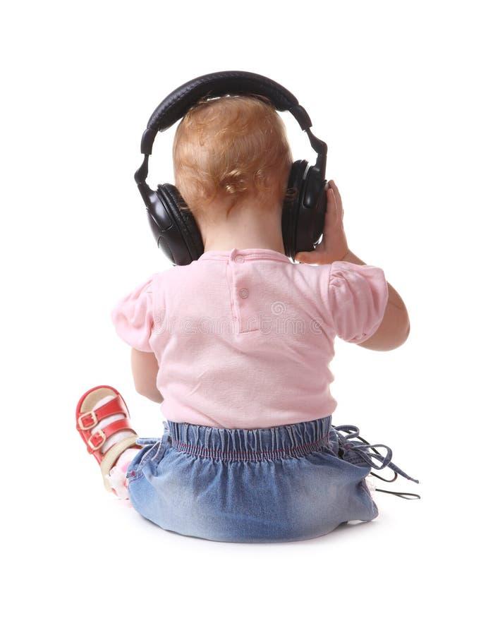 dziecko słucha muzykę zdjęcia stock