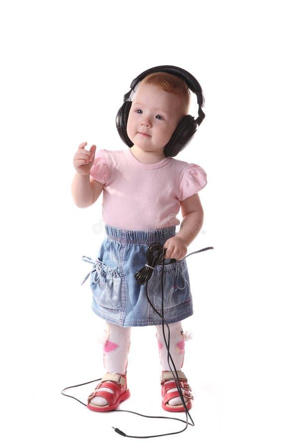 dziecko słucha muzykę obrazy stock