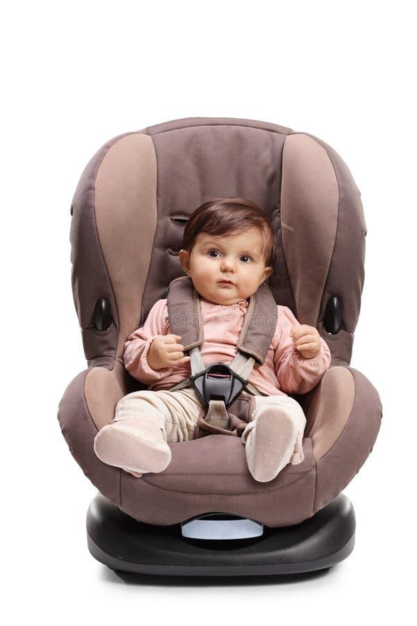 Dziecko troczący w samochodowym siedzeniu zdjęcie stock